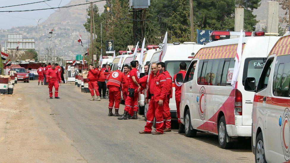 Syrian Red Crescent ambulances wait to enter Zabadani on 12 April 2017