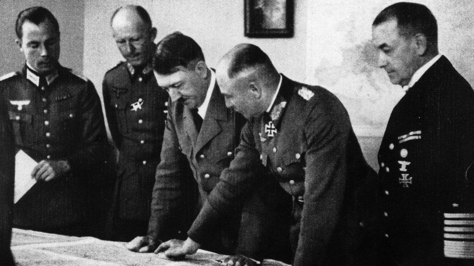 Hitler speaking to some of his generals