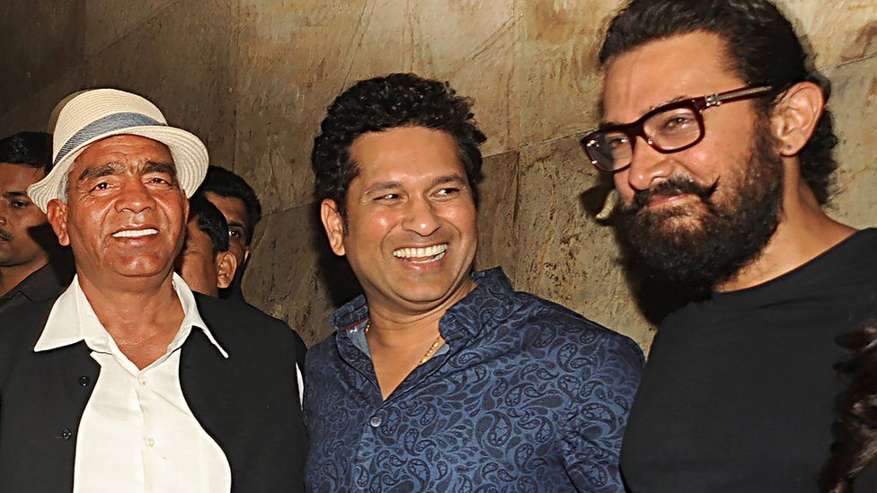 Indian amateur wrestler and Olympic coach, Mahavir Singh Phogat, (L), former Indian cricketer, Sachin Tendulkar (C) and Bollywood actor Aamir Khan attend the special screening of the biographical sports drama Hindi film 'Dangal',