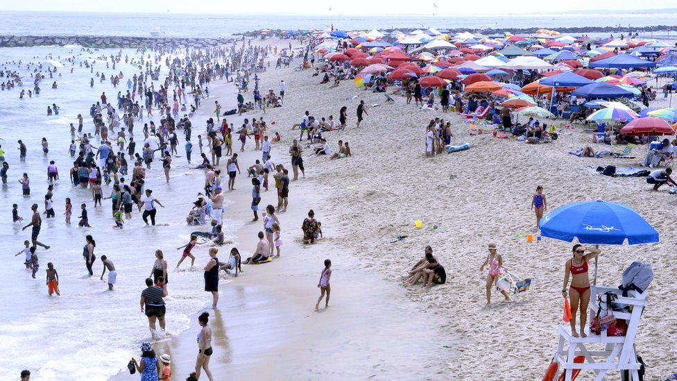 Bathers at the beach in Ocean City, Maryland, 22 July 2017