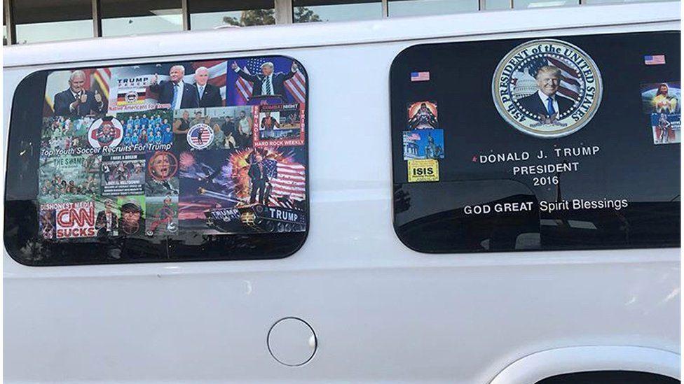 Mr Sayoc's van with pro-Trump images and an image reading 'CNN SUCKS dishonest media'