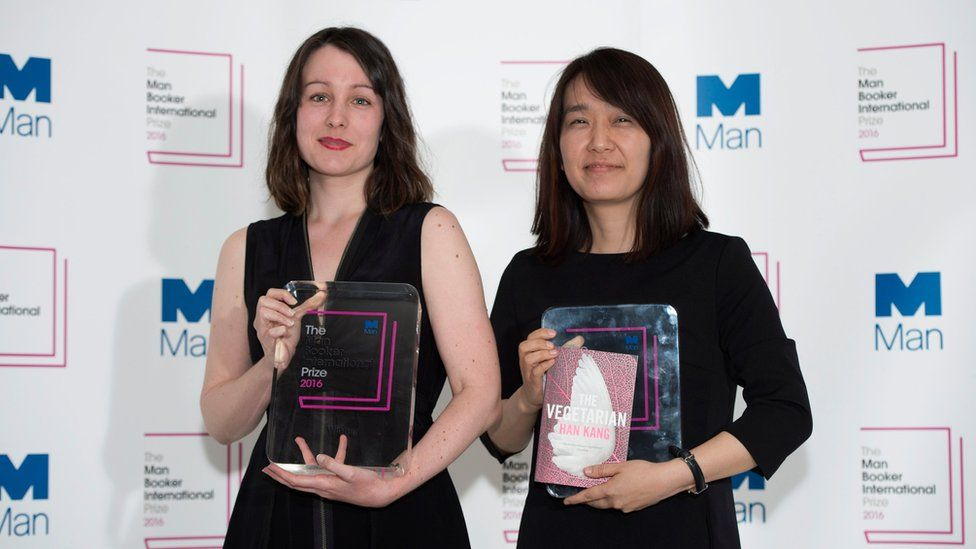 Han Kang (right), author of The Vegetarian, poses for photographers with translator Deborah Smith (left) after winning the Man Booker International Prize on 16 May 2016