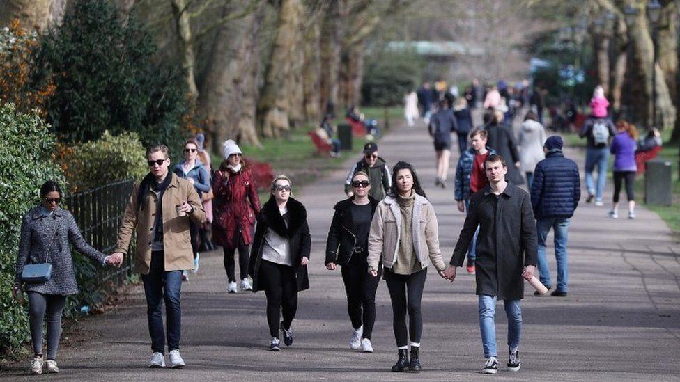 People walking through Battersea Park