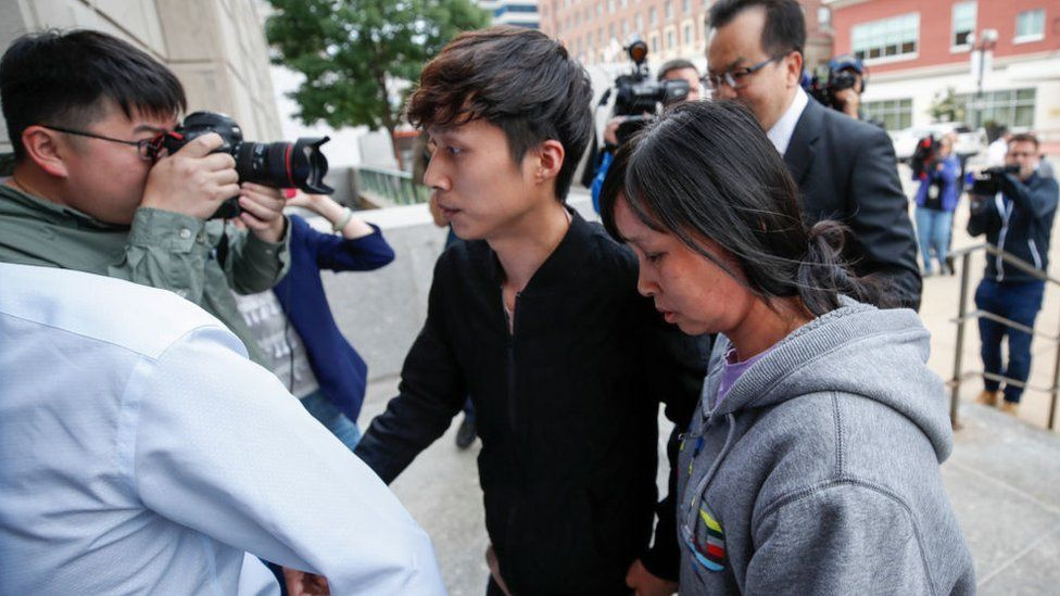 Mother Lifeng Ye (R) and brother Zhengyang Zhang (C) of Yingying Zhang arrive at the US Courthouse as federal trial of Brendt Christensen begins in the 2017 disappearance and suspected killing of Yingying Zhang, a visiting scholar from China whose body has not been found on June 12, 2019 in Peoria, Illinois.