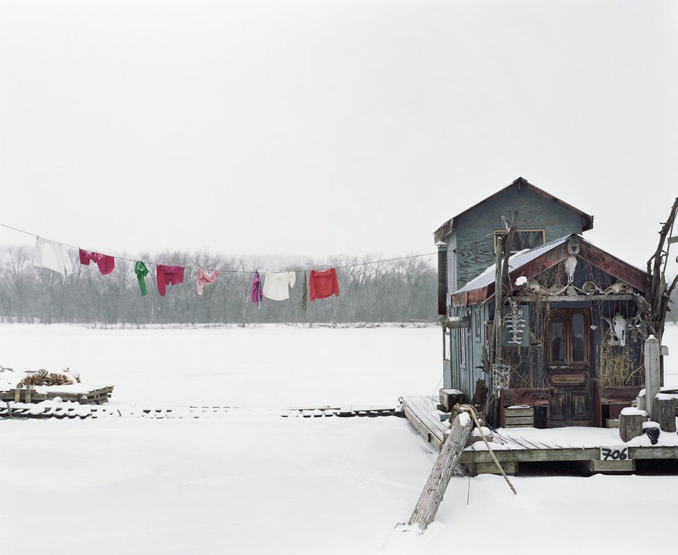 Peter's houseboat, covered in snow.