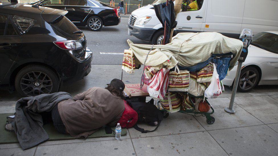 Homeless man sleeps on the street in San Francisco (file photo)