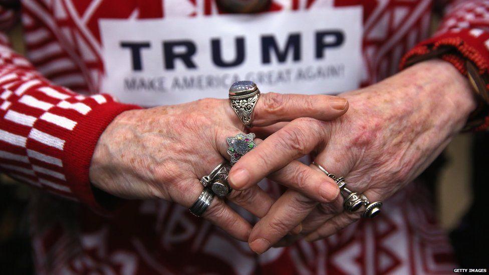 A rally-goer awaits Trumps arrival