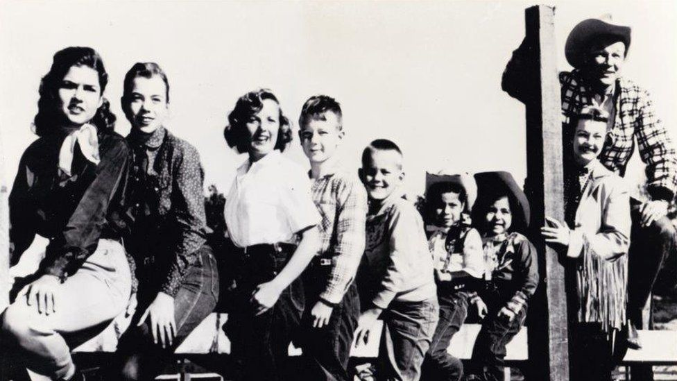 Roy Rogers and Dale Evans with their family on their California ranch - Marion is third left