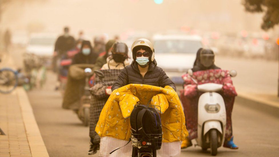 Citizens ride motorbikes in sandstorm on March 15, 2021 in Hohhot, Inner Mongolia Autonomous Region of China.
