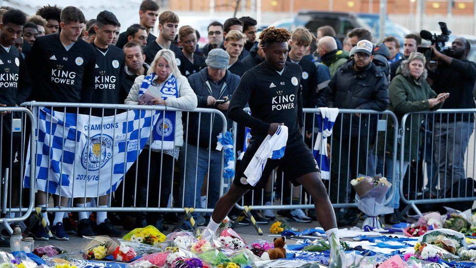 Darnell Johnson steps through tributes to lay football shirt