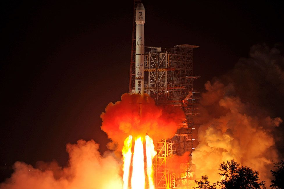 The Chang'e-3 rocket carrying the Jade Rabbit rover blasts off, from the Xichang Satellite Launch Center in the southwest province of Sichuan on December 2, 2013. China launched its first moon rover mission, state TV showed, the latest step in an ambitious space programme seen as a symbol of its rising global stature.