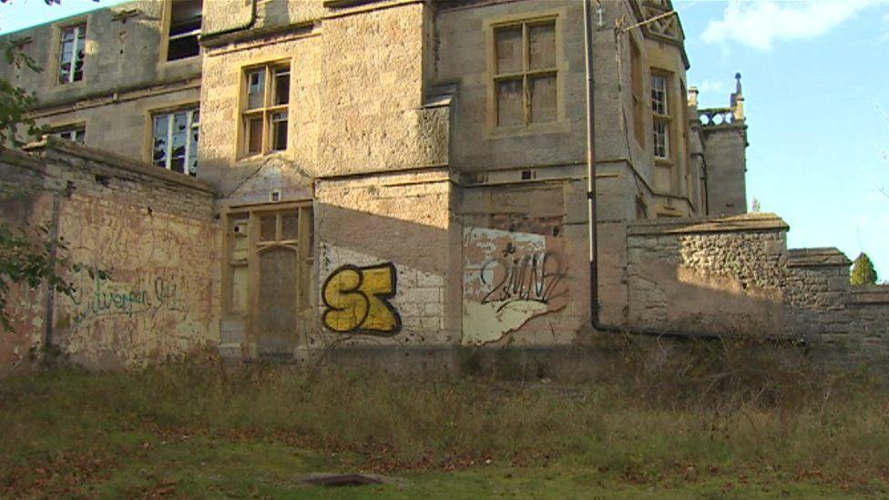 Graffiti daubed on the building exterior