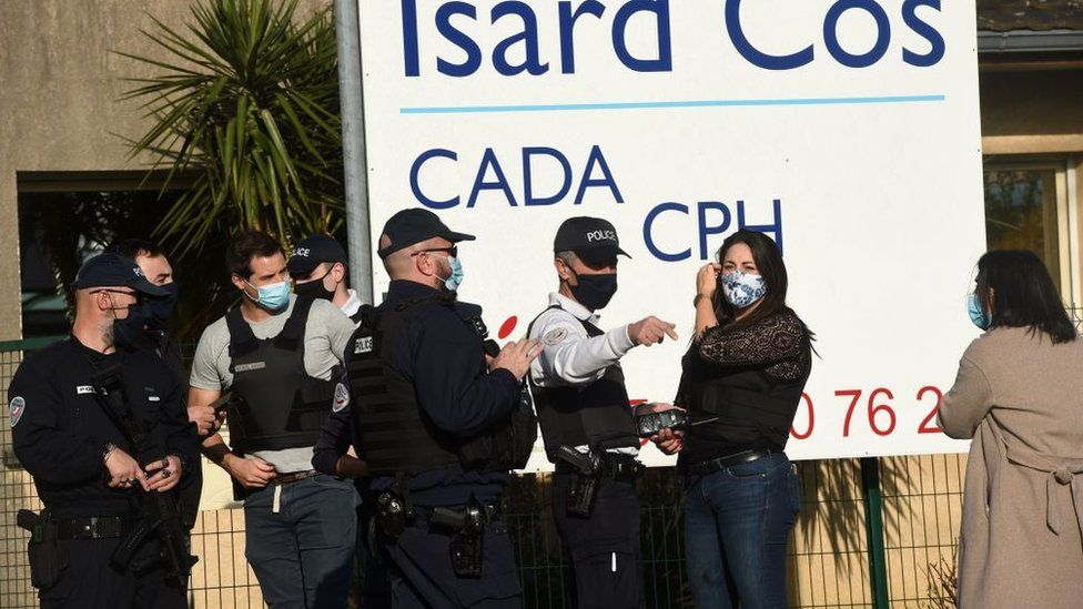 Police outside an immigration centre in the southwestern French city of Pau after a manager there was stabbed to death, 19 February 2021