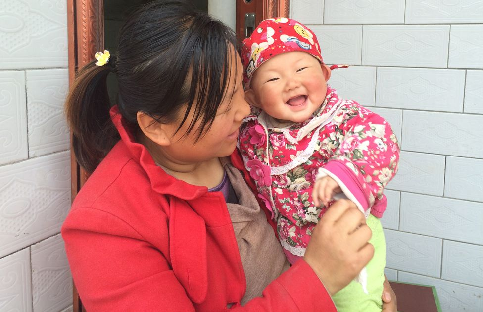 A mother and baby outside the parenting centre in Shaanxi Province