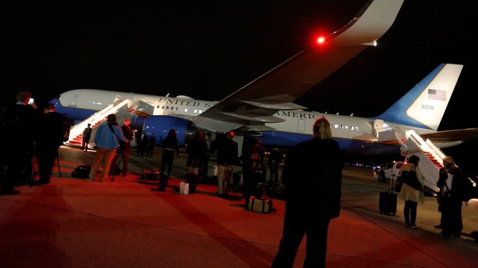 White House staff, Secret Service agents and journalists wait on the tarmac for U.S. President Donald Trump to deplane as he returns from a weekend at his New Jersey golf estate home via Air Force One at Joint Base Andrews, Maryland, U.S. May 7, 2017
