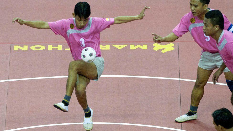 Chinlone players in tournament
