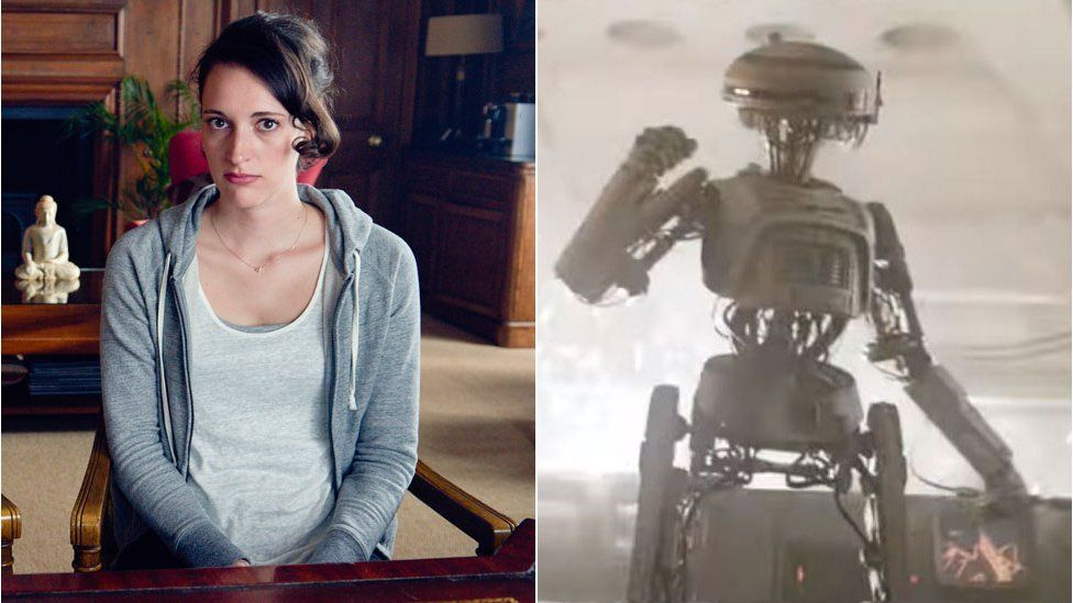 Phoebe Waller-Bridge and a droid from Solo: A Star Wars Story