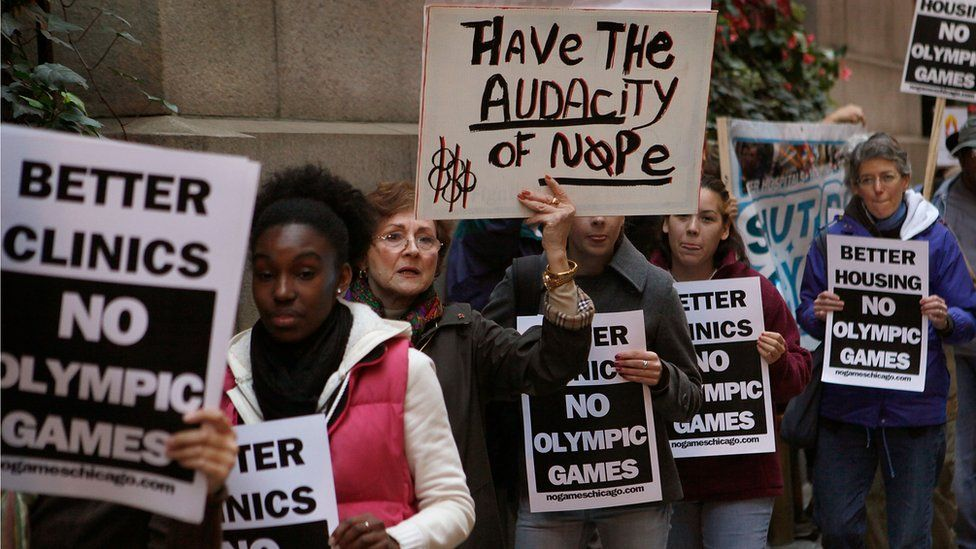 Demonstrators protest outside City Hall against Chicago's bid to host the 2016 Olympics