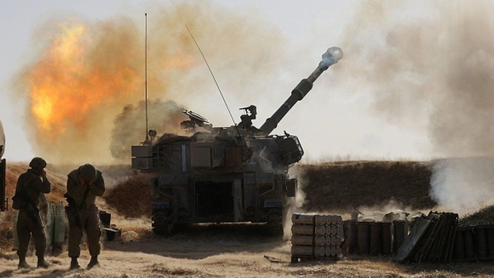 Israeli soldiers fire towards targets in the Gaza Strip on 12 May
