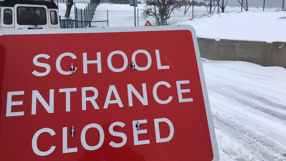 A school entrance closed sign