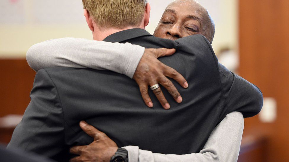 DeWayne Johnson hugs one of his lawyers after hearing the verdict at the Superior Court Of California in San Francisco, on August 10, 2018