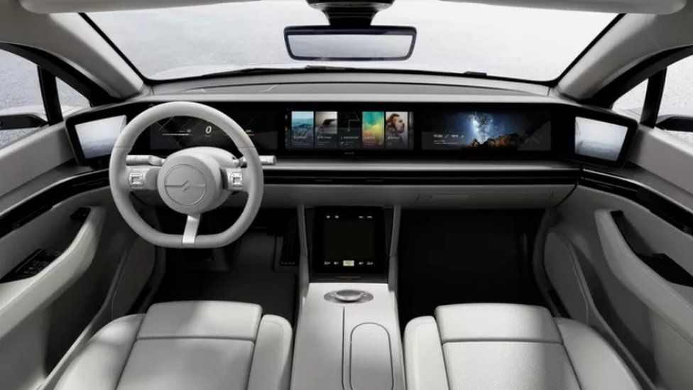 A panoramic dashboard visible inside the concept car