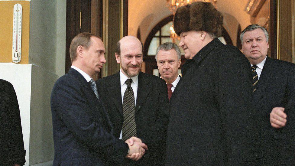Putin shaking hands with Boris Yeltsin