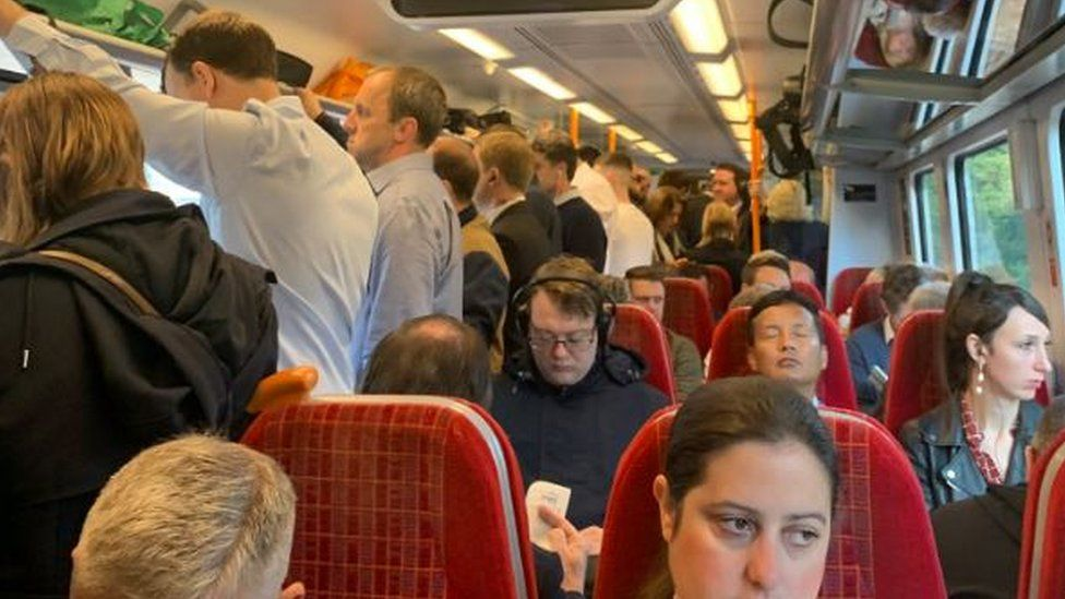 Overcrowded train at Woking