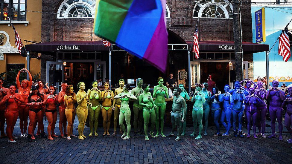 People painted in rainbow colours in solidarity with victims of Pulse nightclub shootings, Orlando, 17 June 2016