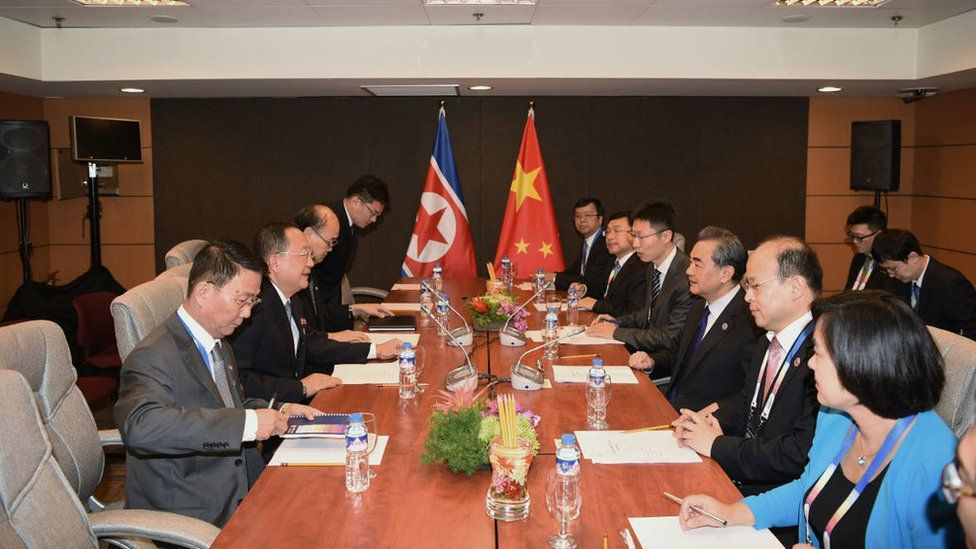 China's Foreign Minister Wang Yi (3rd R) speaks with North Korea's Foreign Minister Ri Yong Ho (2nd L) during their bilateral meeting on the sidelines of the Association of Southeast Asian Nations (ASEAN) regional security forum in Manila