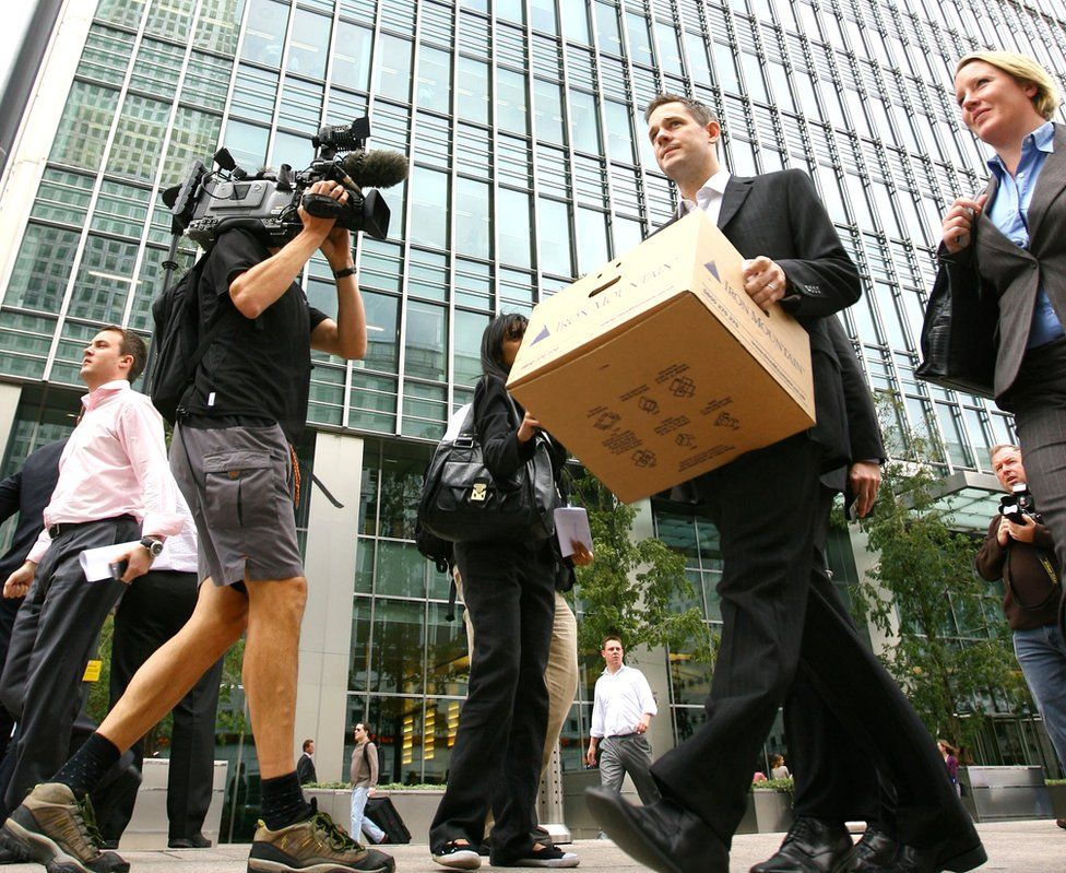 Lehman Brothers staff leaving the London HQ after the firm filed for bankruptcy