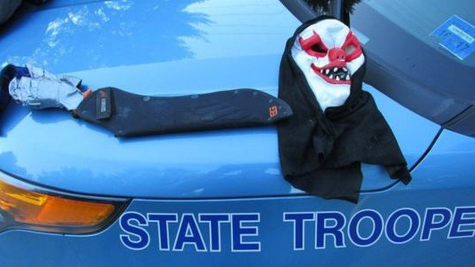 A handout picture from Maine State Police shows a clown mask and the machete which had been taped to the stump of Corey Berry's arm