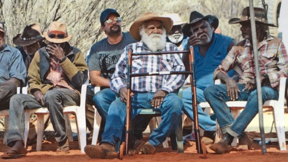 Rameth Thomas sits with other traditional owners of Uluru