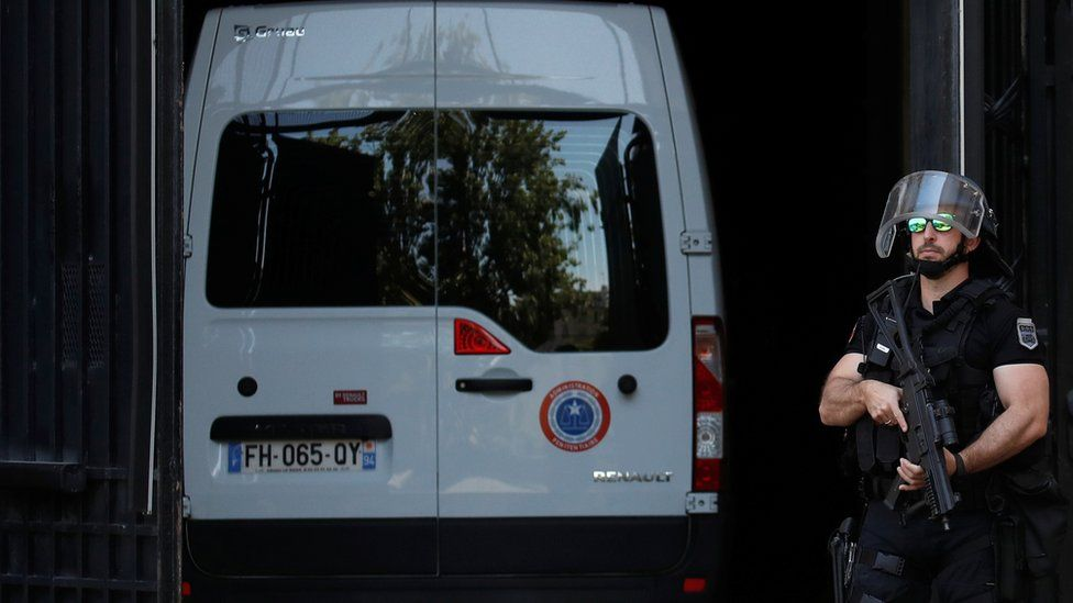 A police convoy believed to be carrying Rwandan genocide fugitive Felicien Kabuga arrives at the Paris courthouse