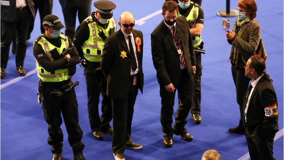 Police escort Liberal Party member from count