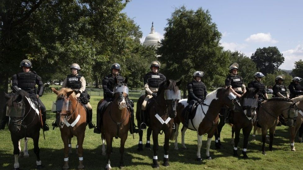 """Mounted police stand by near the """"Justice for J6"""" protest on Capitol Hill in Washington, DC, USA, 18 September 2021"""