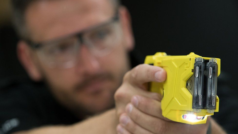 A taser being demonstrated