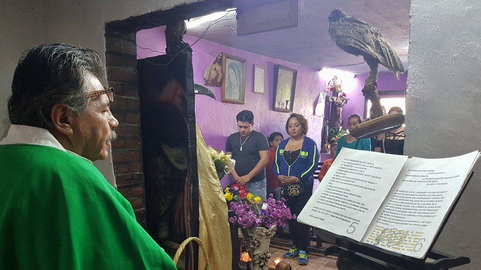 Mr Santana officiates at the temple to Santa Muerte in Guadalajara
