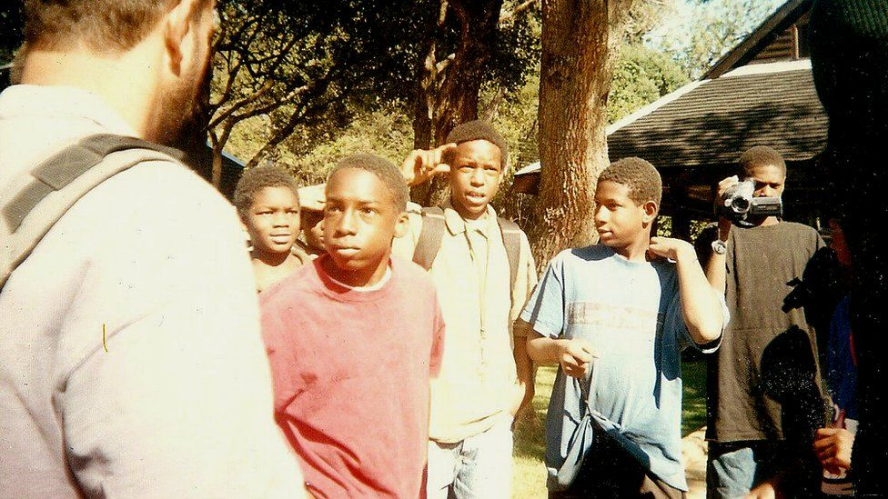 Devon Brown in the red shirt with a counsellor and other Baraka students