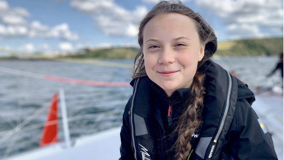 Greta Thunberg on board a solar-powered yacht Malizia II as Greta prepares to set sail from Mayflower Marina Plymouth in the UK across the Atlantic