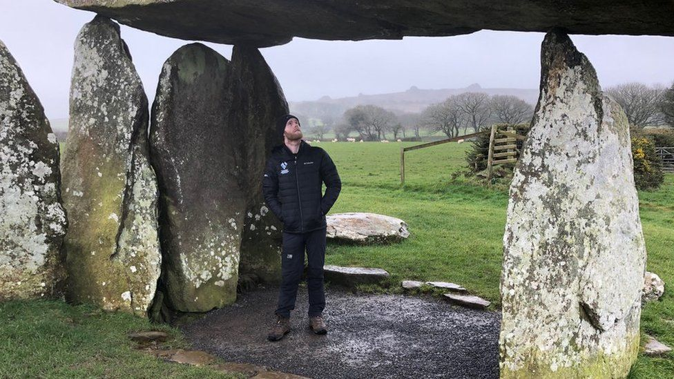 Archaeologist Tomos Jones at Pentre Ifan Neolithic burial chamber