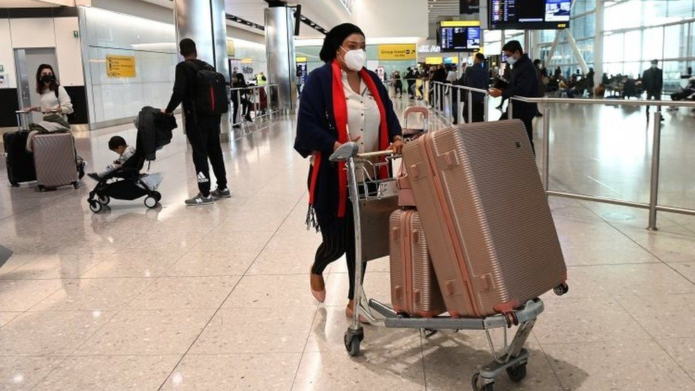 Travellers arriving at Heathrow airport