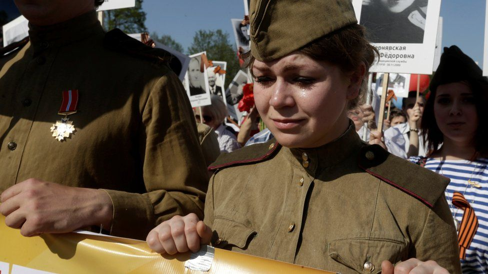 A woman cries as she takes part in the Immortal Regiment march during the Victory Day celebrations in Riga, Latvia, May 9, 2016. REUTERS/Ints Kalnins