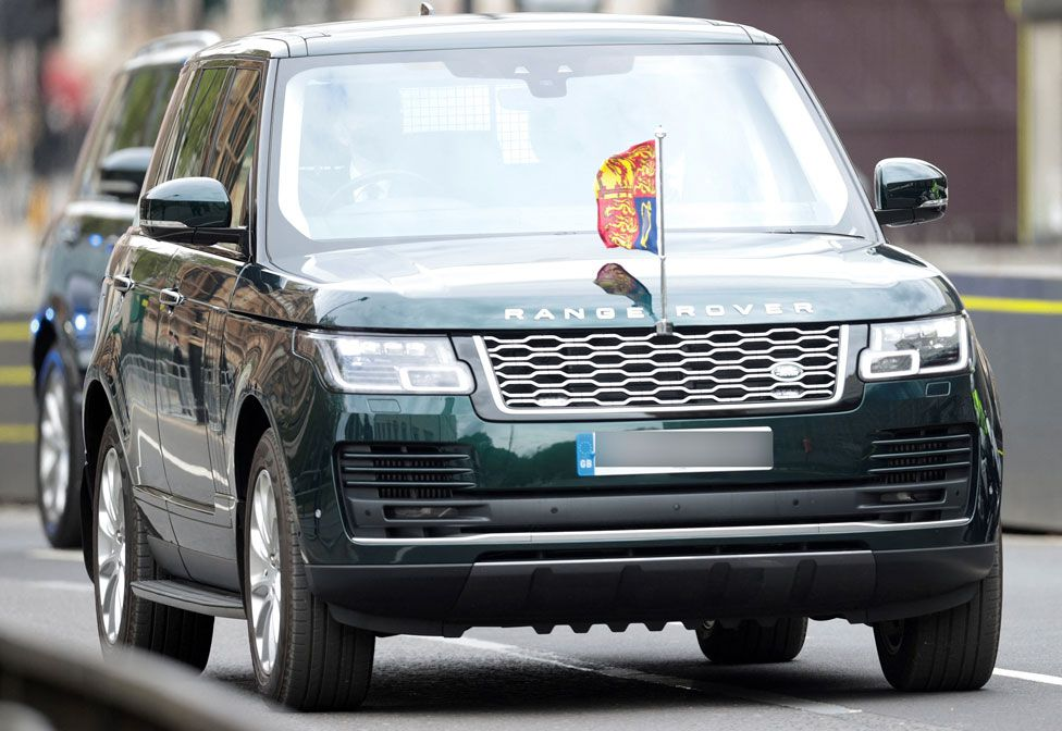 Britain's Queen Elizabeth II is driven in a Range Rover to the Houses of Parliament for the State Opening of Parliament