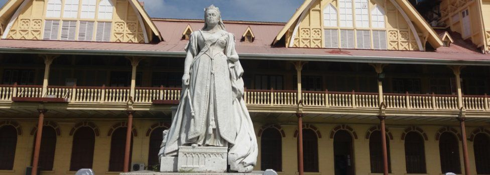 A view of the statue of Queen Victoria in front of the Supreme Court in Georgetown