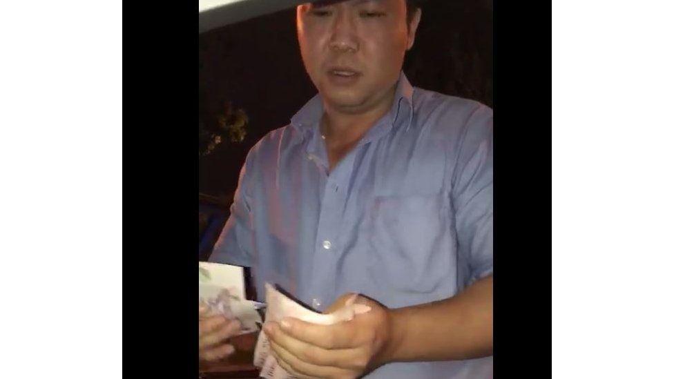 Gary Lim counting bills