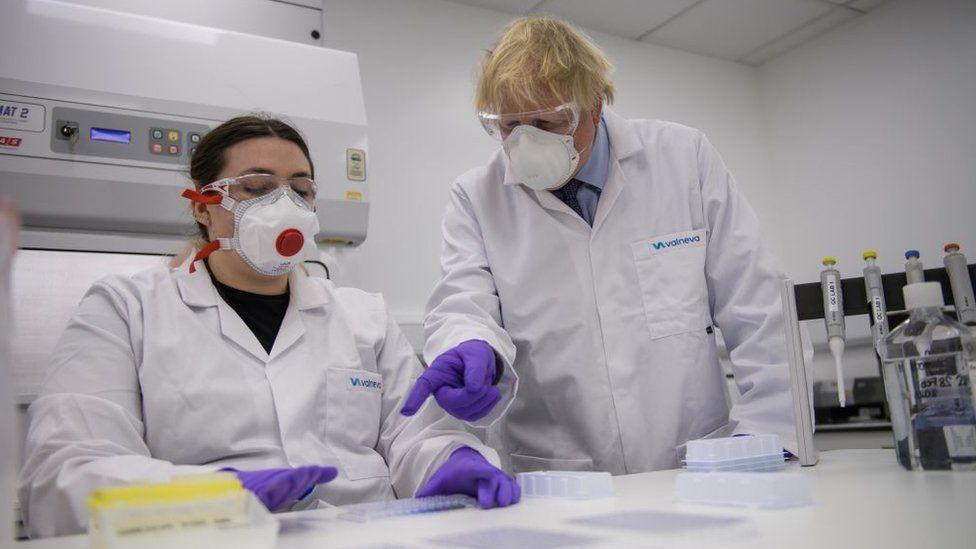 Boris Johnson and a worker at the Valneva site in Scotland.