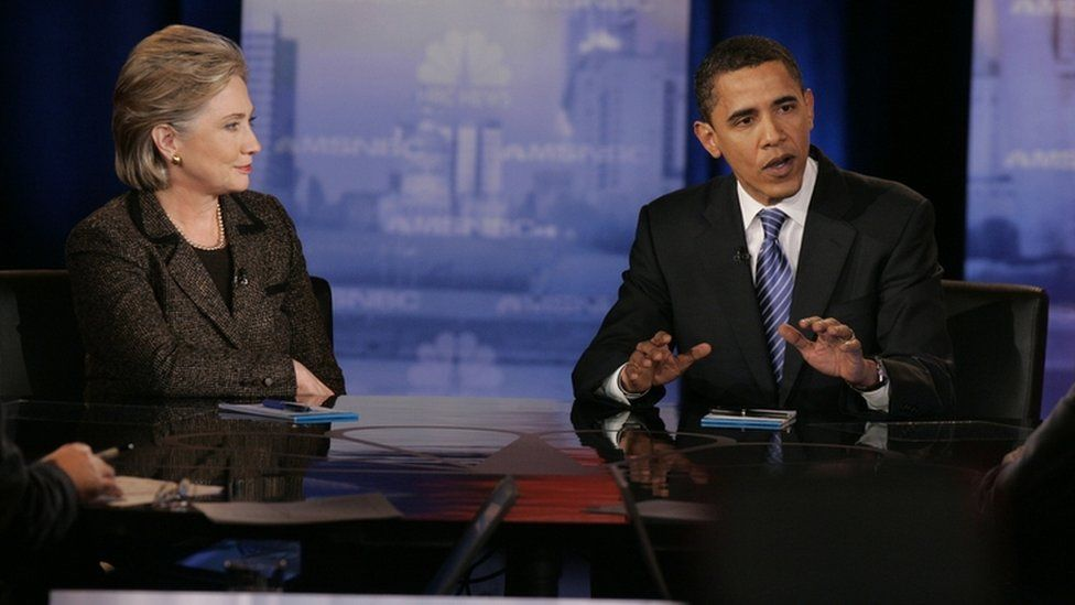 """Hillary Clinton looks on as Barack Obama speaks during a debate at Cleveland State University""""s Wolstein Center February 2008"""