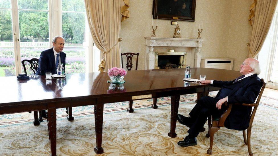 Ireland's new Taoiseach (Prime Minister) Micheal Martin (L) attending a meeting with Irish President Michael D. Higgins