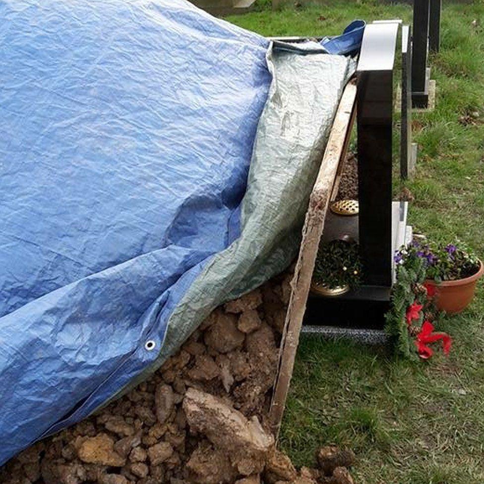 Rubble on grave